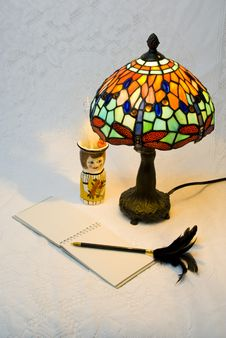 Free Lit Lamp With Notepad And Pen Royalty Free Stock Photos - 2908338