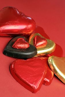 Free Red And Gold Wrapped Chocolates Against A Red Background, Vertical Stock Photos - 29004183