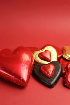 Free Red And Gold Wrapped Chocolates, Vertical With Copy Space. Royalty Free Stock Photos - 29004228
