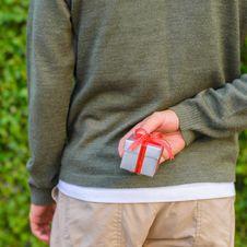 Free Man Hide Gift Box Behind His Back Royalty Free Stock Photos - 29005908