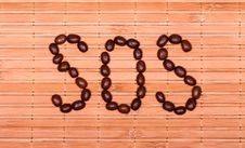 Free SOS From Coffee Beans On A Decorative Straw Royalty Free Stock Image - 29008496