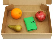 Free Pomegranate, Pear, Orange And Green Wallet In A Box Royalty Free Stock Photography - 29010767