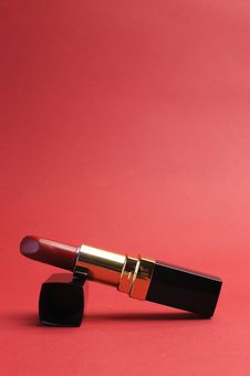 Free Luxury Red Lipstick Against A Red Background, Vertical With Copy Space Royalty Free Stock Photos - 29013138