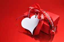 Free Love Theme Red Present With Heart Gift Tag Royalty Free Stock Image - 29013286