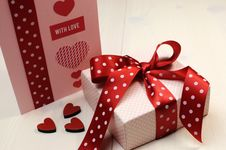Love Theme Ft Card With Pink Gift And Red Polka Dot Ribbon And Hearts.