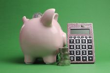 Free Savings And Shopping Sale Concept With Piggy Bank, Stack Of Coins And Calculator Stock Image - 29019051