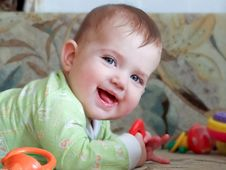 Free Little Child Lying On Her Stomach Stock Images - 29020224