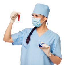 Free Woman Doctor With Red Flask In Their Hands Stock Photography - 29025862