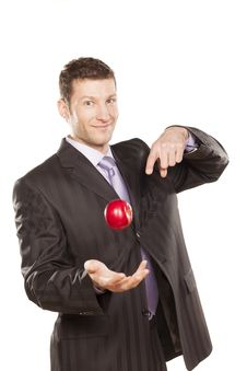 Free Businessman Tossing Apple Royalty Free Stock Photo - 29032535