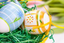 Easter Eggs With Bows In The Basket Royalty Free Stock Image