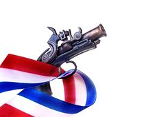 Free Red White & Blue Ribbon & Gun Royalty Free Stock Photography - 29077417