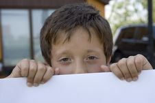 Free Boy Keeps Sheet Of Paper Stock Photo - 2910080
