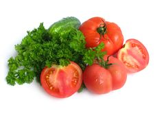 Cucumbers, Tomatoes And Greens Stock Photos