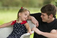 Free Little Girl Adoring Young Man Stock Image - 2915101