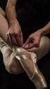 Free Ballerina Preparing Her Ballet Shoes Stock Image - 29110661