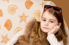 Young Girl With Sunglasses On Her Head Royalty Free Stock Image