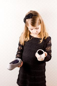 Free Little Girl Making A Choice Of Shoes Stock Photo - 29110540