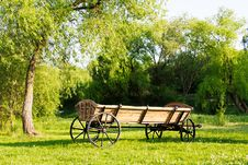 Free Cart Among Green Grass Landscape Stock Image - 29113561