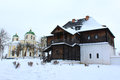 Free The Wooden House And Beautiful Church In Winter Stock Photo - 29123070