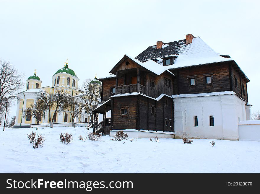 The wooden house and beautiful church in winter