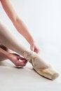 Free Ballerina Preparing Her Ballet Shoes Stock Images - 29137454
