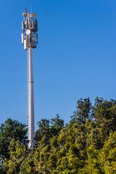 Telecommunication Mast And Green Trees Stock Image