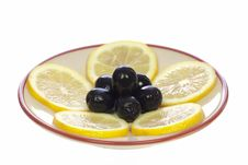 Free Lemons And Olives On The Saucer Royalty Free Stock Photos - 29146868