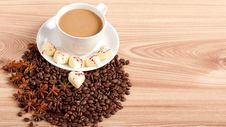 Free Cup Of Coffee With Beans And White Chocolate Heart Candy  Over Wooden Background Royalty Free Stock Images - 29158339