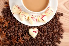 Free Cup Of Coffee With Beans And White Chocolate Heart Candy  Over Wooden Background Royalty Free Stock Image - 29158366