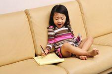 Little Girl Writing Stock Photography