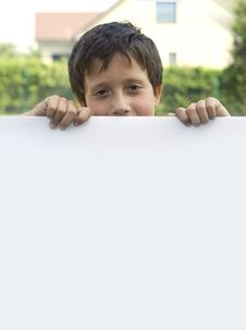 Boy Keeps Sheet Of Paper Stock Images