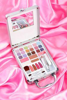 Makeup Briefcase On Pink Satin Stock Image