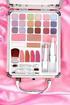 Makeup Briefcase On Pink Satin Royalty Free Stock Image