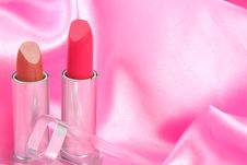 Free Lipstick On Pink Satin Royalty Free Stock Photography - 2923887