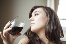 Free Young Woman In Lingerie Drinking Red Wine Royalty Free Stock Photography - 29210027