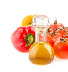 Bottle With Olive Oil ,tomatoes And Peppers Royalty Free Stock Images