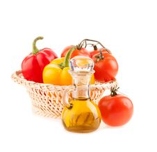 Bottle With Olive Oil On The Background Of The Wattled Dish Stock Image