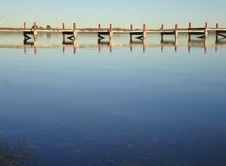 Free Pier Reflected At Calm Lake Stock Images - 29231284