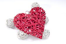 Red Wicker Heart Resting On Six Small White Wicker Balls Stock Photography