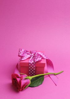 Pink Polka Dot Gift With Rose - Vertical With Copy Space. Royalty Free Stock Photos