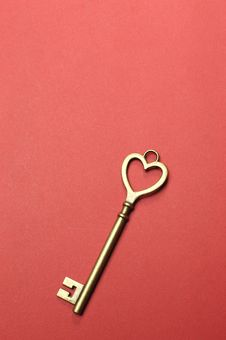 One Heart Shape Gold Key - Vertical. Royalty Free Stock Photography
