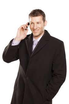 Free Smiling Man In A Coat Telephones Stock Photos - 29258853