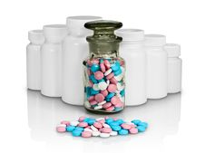 Small Group A Pill Against Small Bottles With Pills. Stock Photos
