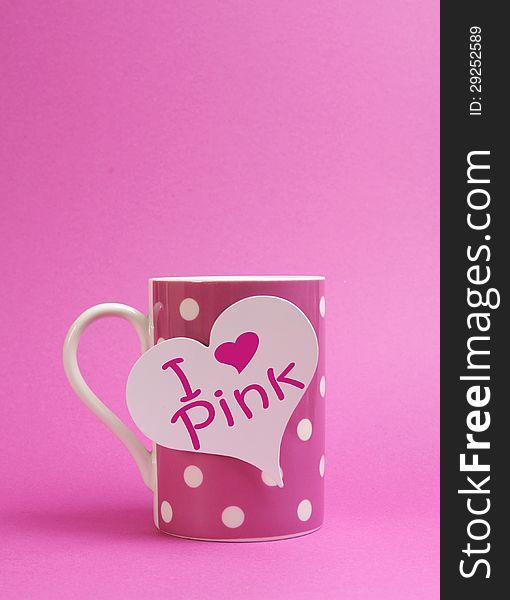 I Love Pink message on heart sign on pink polka dot coffee mug