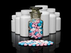 Small Group A Pill Against Small Bottles With Pills. Stock Images
