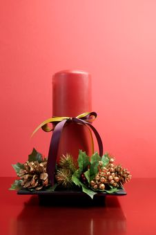 Free Red Candle With Holly And Pine Cone Christmas Table Centrepiece Still Life Royalty Free Stock Photography - 29263867