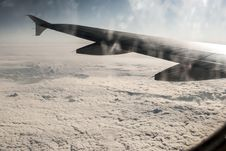 Free Frosty Patterns At A Plane Window Over Clouds Royalty Free Stock Photos - 29266548
