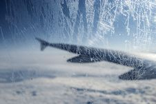 Free Frosty Patterns At A Plane Window Over Clouds Stock Images - 29266604