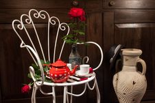 Still Life With Antique Chair, Flowers And Tea Stock Image