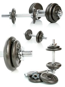 Iron Dumbbells Set On White Stock Photos